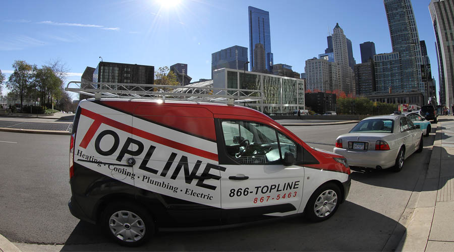Heating & Cooling Repair Services in the Chicago Metro Area - image of Topline HVAC truck in downtown Chicago